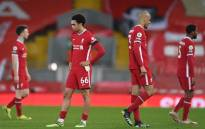 Liverpool's Trent Alexander-Arnold (L) and Fabinho react at the final whistle during the English Premier League football match between Liverpool and Chelsea at Anfield in Liverpool, northwest England on 4 March 2021. Picture: Laurence Griffiths/AFP