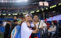 Australian Ashleigh Barty takes a selfie with a fan after her victory over Angelique Kerber at the Wuhan Open on 26 September 2018. Picture: @wuhanopentennis/Twitter