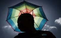 A member of the South African lesbian, gay, bisexual and transgender and intersex (LGBTI) community holding an umbrella in the rainbow flag colours takes part in the annual Gay Pride Parade, as part of the Durban Pride Festival, on 29 June 2019 in Durban. Picture: Rajesh JANTILAL/AFP