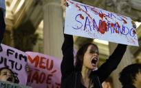 Brazilians protest in front of the Legislative Assembly of Rio de Janeiro (ALERJ) on 27 May 2016, against a gang-rape of a 16-year-old girl. Picture: AFP.
