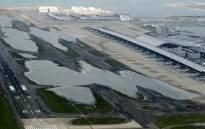An aerial view from a Jiji Press helicopter shows flooding at the Kansai International Airport in Izumisano city, Osaka prefecture on 5 September 2018, after typhoon Jebi hit the west coast of Japan. Picture: AFP