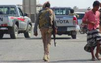 A Yemeni fighter loyal to the Saudi-backed Yemeni president walks down a street in the town of Khokha in the western province of Hodeidah on 18 December 2018. Picture: AFP