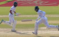 Pakistan's Fawad Alam (L) and Faheem Ashraf run between the wickets during the second day of the first cricket Test match between Pakistan and South Africa at the National Stadium in Karachi on 27 January 2021. Picture: Asif HASSAN/AFP