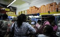 Parents purchasing school uniforms and supplies for their children the day before schools reopen. Picture: Abigail Javier/EWN