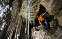 Efraim Cohen of the Israel Cave Explorers Club, and of the Malham Cave Mapping Expedition, shows journalists salt stalactites in the Malham cave inside Mount Sodom, located at the southern part of the Dead Sea in Israel on 27 March 2019. Picture: AFP