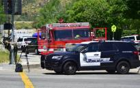 FILE: A police vehicle stands at a closed-off street outside the North Park Elementary School in San Bernadino, California on April 10, 2017 after a gunman entered a classroom and killed one woman and one student before turning the gun on himself. Picture: AFP