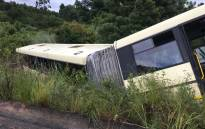 A bus lies on the side of the road after colliding with a car on the R538 Numbi Road just past White River in Mpumalanga. Picture: ER24.