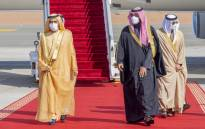 A handout picture provided by the Saudi Royal Palace on 5 January 2021, shows Crown Prince Mohammed bin Salman (R) welcoming Dubai's ruler and UAE Vice President Sheikh Mohammed bin Rashid Al-Maktoum upon his arrival in the city of al-Ula in northwestern Saudi Arabia for the 41st Gulf Cooperation Council summit. Picture: AFP