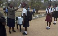 Temperatures are taken of pupils returning to Anderson Adventist Secondary in Gweru, Zimbabwe, on 28 September 2020. Picture: Twitter/@nickmangwana