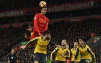 Liverpool's German-born Cameroonian defender Joel Matip jumps to win a header during the English Premier League football match between Liverpool and Arsenal at Anfield in Liverpool, north west England on 4 March 2017. Picture: AFP.