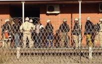 Platinum Mineworkers report for work at a Lonmin shaft in Marikana on 15 May 2014. Vumani Mkhize/EWN.