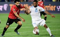 Egypt's Mohamed Salah (L) fights for the ball with DR Congo's Elia Meschak during the 2019 Africa Cup of Nations football match between Egypt and DR Congo at the Cairo International Stadium on June 26, 2019. Picture: AFP