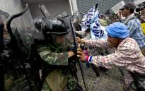 FILE: Thai farmers battle with soldiers in Bangkok. Picture: AFP.
