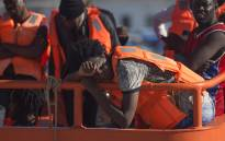 A Spanish coast guard boat with migrants onboard arrives at Malaga's harbour on 23 September 2018, after an inflatable boat carrying 117 immigrants, 34 of them women and 4 children, was rescued by the Spanish coast guard off the Spanish coast. Picture: AFP