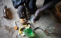 FILE: An addict of the drug cocktail known locally as nyaope prepares to inject himself with the drug in an abandoned building in Simuneye township on the outskirts of Johannesburg. Picture: AFP.