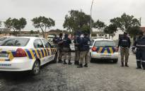City of Cape Town law enforcement officials monitor protesters in Gugulethu on 12 July 2018. Picture: Lauren Isaacs/EWN