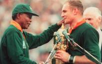 FILE: Springbok captain Francois Pienaar (right) is congratulated by South African President Nelson Mandela after South Africa won the Rugby World Cup final against New Zealand 24 June 1995 in Johannesburg. Picture: AFP