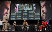 Broadcaster Kate Abdo (C) moderates a news conference for WBC heavyweight champion Tyson Fury (L) and Deontay Wilder (2nd R) at MGM Grand Garden Arena on 6 October 2021 in Las Vegas, Nevada. Picture: Ethan Miller/AFP