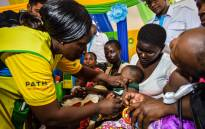 FILE: A health worker vaccinates a child against malaria in Ndhiwa, Homabay County, western Kenya on 13 September 2019 during the launch of malaria vaccine in Kenya. Picture: Brian ONGORO/AFP
