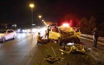 ER24 attend a motor vehicle accident involving a Toyota Hilux and a container truck. Picture: Thomas Holder/EWN