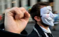 The Guy Fawkes mask has become the icon for the Anonymous protest group. Picture: AFP.