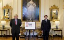 A handout image released by 10 Downing Street, shows Britain's Prime Minister Boris Johnson (L) posing for a photograph with French President Emmanuel Macron (R) inside 10 Downing Street in central London on 18 May 2020.  Picture: AFP