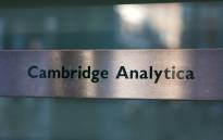 FILE: A Cambridge Analytica sign is pictured at the entrance of the building which houses the offices of Cambridge Analytica, in central London on 21 March 2018. Picture: AFP.