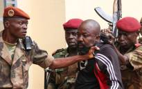 "In this file photo taken on 29 October, 2018 members of the armed forces arrest Central African Republic MP Alfred Yekatom aka ""Rambo"" (C), who represents the southern M'baiki district former militia leader, after he fired the gun at the parliament in Bangui. Yekatom was extradited on 17 November 2018 to The Hague, The Netherlands, after an arrest warrant was issued by the International Criminal Court. Picture: AFP"
