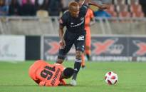 Orlando Pirates's Linda Mntambo battles with his Polokwane City opponent during their Absa Premiership match on 6 November 2018. Picture: @orlandopirates/Twitter