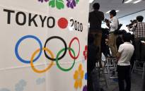 Photographers take pictures during the meeting of the Tokyo 2020 additional event programme panel. Picture: AFP.