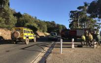Firefighters take a break from their duties on the Signal Hill road in Cape Town on 28 January 2019. Picture: Monique Mortlock/EWN