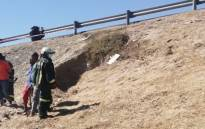 A fireman surveys the area where four children fell into a hole while playing on sand dunes near the N2 Borcherds Quarry intersection in Gugulethu on 8 February 2021. Picture: Supplied