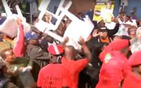 A screengrab of fighting at an SABC election broadcast in Hout Bay on 5 April 2019.