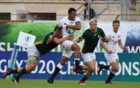 England's Jordan Olowofela shrugs off his South African opponents during their World Rugby Under-20 Championship match on 12 June 2018. Picture: @WorldRugby/Twitter