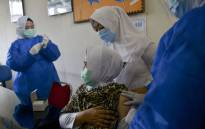 FILE: A health worker administers the Sinovac vaccine against the COVID-19 coronavirus at a community health centre in Lambaro, Indonesia's Aceh province on 18 January 2021. Picture: AFP