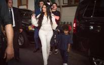 US reality television star Kim Kardashian waves her hand as she walks with her son Saint in Yerevan on 7 October 2019. The US reality television star Kim Kardashian baptised her children during a visit to her ancestral homeland Armenia. Picture: AFP