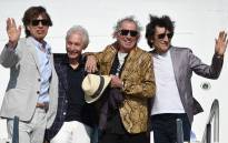 The Rolling Stones (L-R) Mick Jagger, Charlie Watts, Keith Richards and Ron Wood, are pictured upon landing in Montevideo on 15 February 2016. Picture: AFP/PABLO PORCIUNCULA