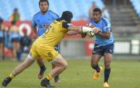 Bulls scrumhalf Rudy Paige (right) looks to get past Hurricanes prop Jeffery Toomaga-Allen in their 2017 Super Rugby match. Picture: AFP