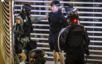 Riot police arrest a protester inside the City Plaza mall in the Tai Koo Shing area in Hong Kong on 3 November 2019. Picture: AFP
