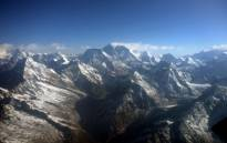 FILE: This photograph taken from an aircraft shows an aerial view of Mount Everest (C) and The Himalayan mountain range. Picture: AFP.