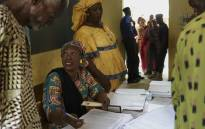 Electoral Commission officials deliver secure voter cards during a distribution in Bamako on 20 June 2018 ahead of the upcoming presidential elections on 29 July. Picture: AFP.