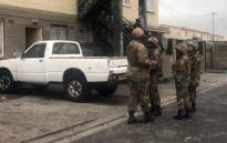 SANDF troops support a police raid in Manenberg on 18 July 2019. Kaylynn Palm/EWN