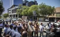 Representatives and coordinators of the #ShutdownGauteng movement marched outside the JSE on 9 October 2018, delivering a memorandum of demands to its officials. Picture: Thomas Holder/EWN