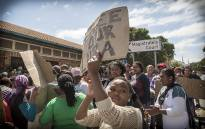 Masiphumelele residents gathered outside Simons Town Magistrates Court in support of community activist Lubabalo Vellem, who has been accused of murder after he allegedly assaulted a man in his community who later died of his injuries. Picture: Thomas Holder/EWN
