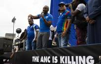 DA members in front of a newly unveiled billboard in Johannesburg on 16 January 2019. Picture: Kayleen Morgan/EWN