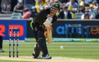 Australian batsman David Warner hits the ball during the first international T20 cricket match between Australia and Sri Lanka at the Adelaide Oval on 27 October 2019. Picture: AFP
