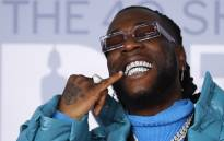 Nigerian singer-songwriter Burna Boy poses on the red carpet on arrival for the BRIT Awards 2020 in London on 18 February 2020. Picture: AFP