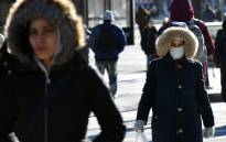 People walk through the freezing cold in the Brooklyn borough of New York on 31 January 2019. A brutal cold wave moved eastward Thursday after bringing temperatures in the US Midwest lower than those in Antarctica, grounding flights, closing schools and businesses and raising fears of hypothermia. Picture: AFP