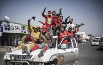 Supporters of Zambian President elect for the opposition party United Party for National Development (UPND) Hakainde Hichilema gestures as they ride on a pick up truck in the streets of Lusaka on August 16, 2021. Picture: Marco Longari / AFP.