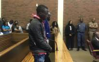Ernest Mabaso and Fita Khuphe, the two men accused of killing seven family members in Vlakfontein, appear in the Lenasia Magistrates Court on 5 November 2018. Picture: Bonga Dlulane/EWN
